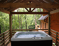 Woodlands cabin #2 hot tub @ Rock Creek Cabins