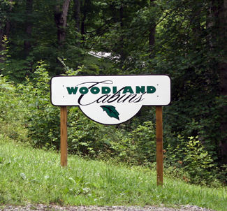 Woodlands Cabins entrance sign @ Rock Creek Cabins