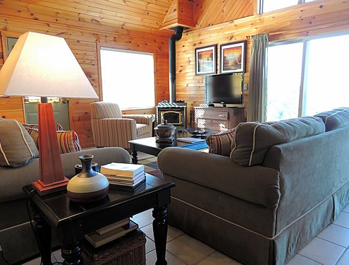 Vista Point living area and wood stove @ Rock Creek Cabins